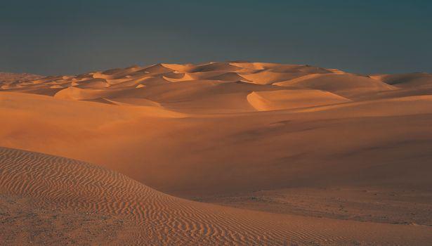 Beautiful Landscape of a Desert. Vast Sandy Dunes Expands into Wildlands. Mild Sunset Lights. Liwa Desert. Abu Dhabi. United Arab Emirates.