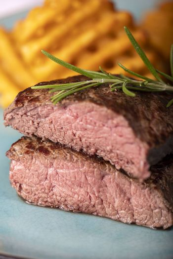 grilled steak with fresh potato lattices