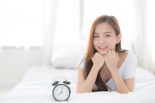Beautiful of portrait young asian woman wake up in morning and a