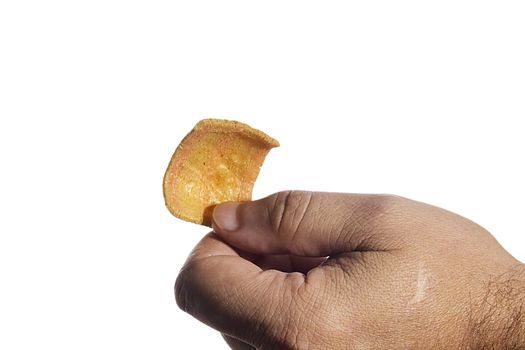 Male hand with snack on white background