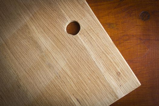 Wooden cutting board on wooden kitchen table