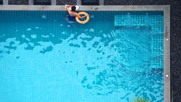 Water streaming corner in swimming pool top view