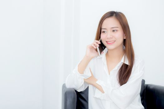 Beautiful of portrait young asian woman smiling sitting relax on the chair, girl using mobile smart phone talking enjoy, communication and social network concept.