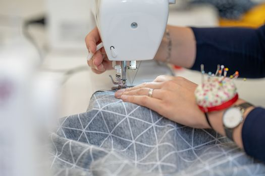 sew dressed on a sewing machine at home and in the studio