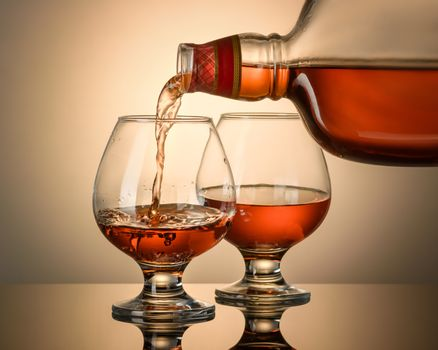 Cognac is poured from a bottle