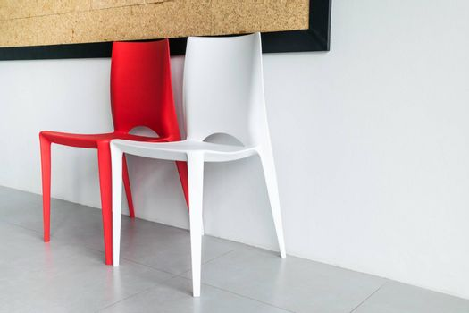 Red and white chairs on the white.