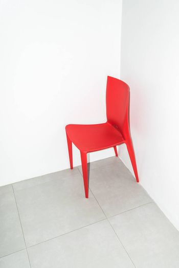 The red chair on the white.