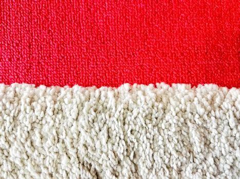Red and white carpet in the room and office.
