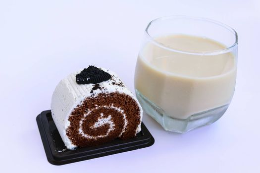 A small sweet cake, typically round, flat, and crisp with milk.