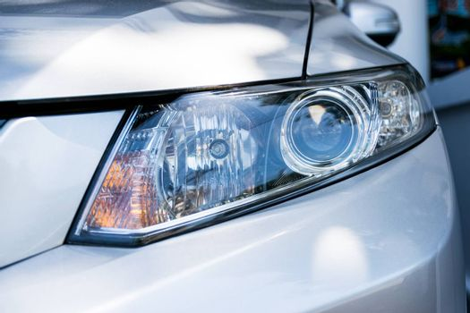 Headlight a powerful light at the front of a motor vehicle