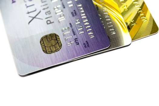 A small plastic card issued by a bank, business, etc., allowing the holder to purchase goods or services on credit.