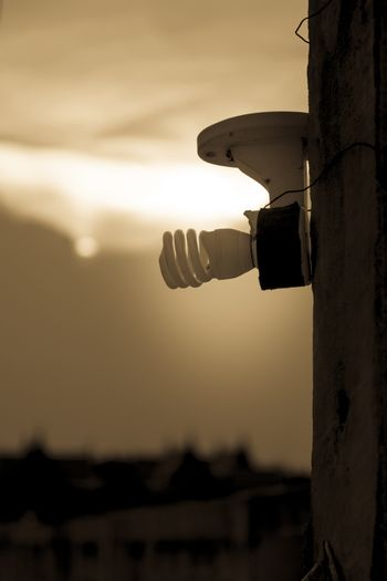 Energy saving light bulbs on the power pole in the evening time.