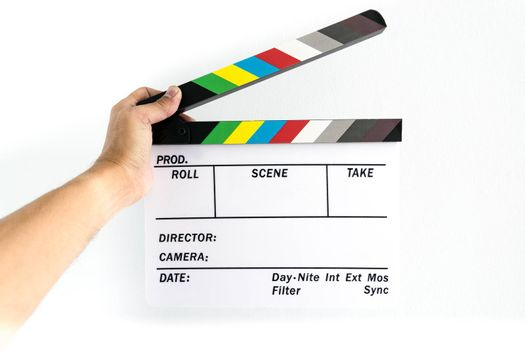 Man's hand holding a slate on hand for the filming.