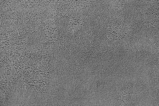 Abstract monochrome fabric pattern background.