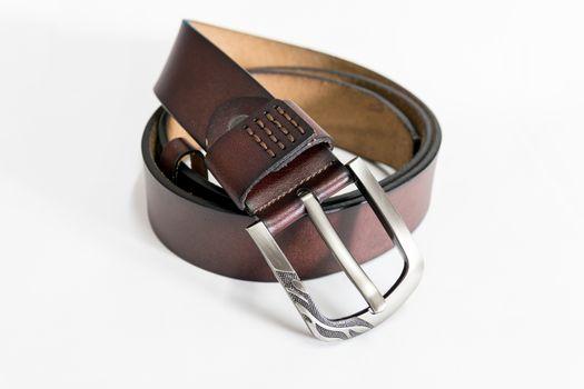 Toe brown leather belt for men.