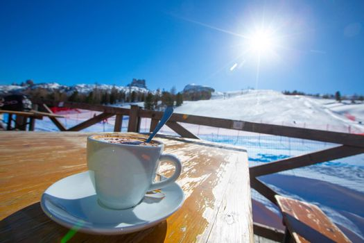 Cappuccino coffee in cafe at ski resort