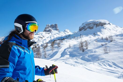 Skier stand on slope in winter mountains