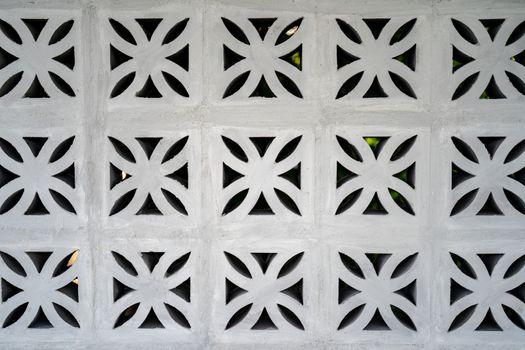 Flower fretwork brick pattern, perforated framework background,