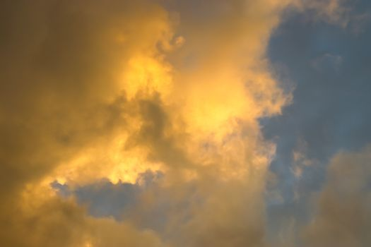 Beautiful panorama of orange and yellow clouds at sunrise and sunset in a blue sky
