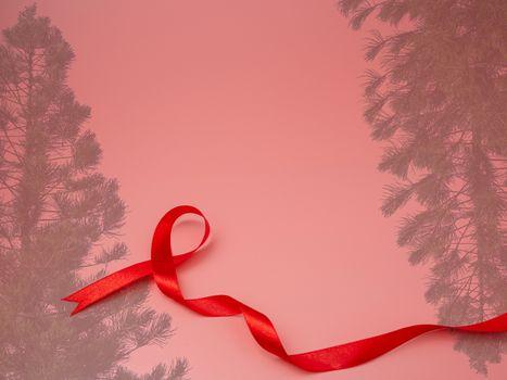 ribbon and christmas tree on Pink christmas background