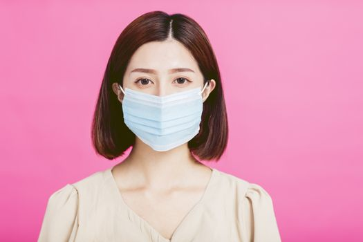 Close-up of  young woman with medical mask on her face