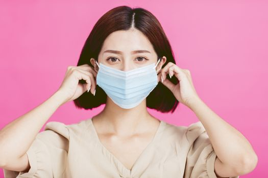 Close-up of  young woman wearing medical mask on her face