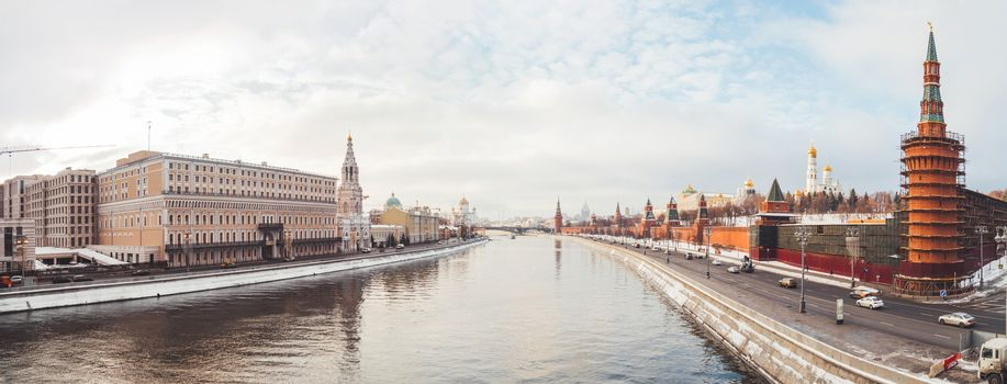 Panorama view of Moscow-river, Kremlin, Ivan the Great Bell tower, Grand Kremlin Palace, Cathedral of the Annunciation. Winter cloudy day in Moscow, Russia.