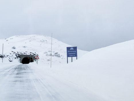 Storehaugtunnelen in Vik, Vestland, Norway. Snow-covered landscape roads.