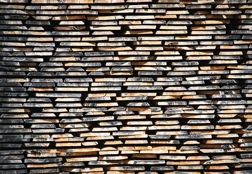 background or texture stacked dried wooden boards