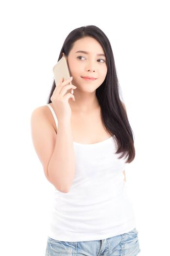 Beautiful of portrait asian young woman smile and happy talking calling with mobile phone isolated on white background, communication concept.
