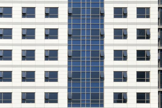 Glass windows of white office building background