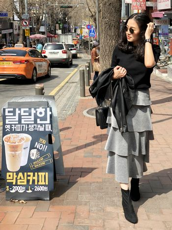 Seoul, South Korea 30 March 2018 : Young beautiful woman shopping and walking around Ewha Womens University Fashion Street which is one of the most popular shopping area