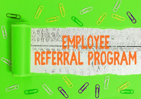 Writing note showing Employee Referral Program. Business photo showcasing employees are rewarded for introducing recruits Rolled ripped torn cardboard above a wooden classic table.