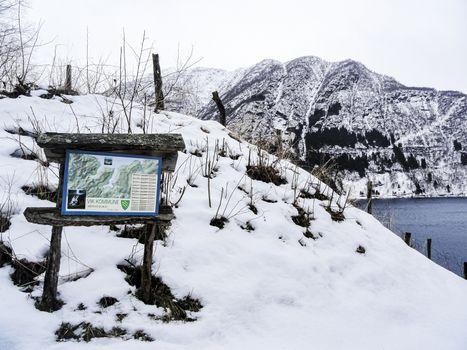 Wooden tourist information sign in winter, Norway, Vik Kommune.