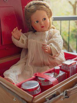 Vintage doll in a vintage suitcase.