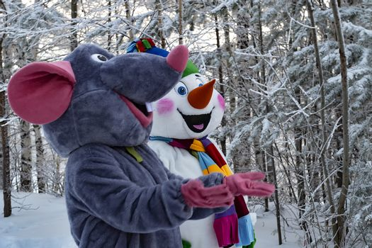 Animators in textile mouse and snowman costume.