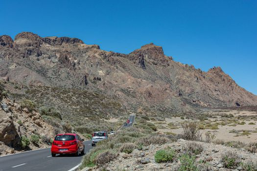 Spain, Tenerife - 05/10/2018: Traffic on a mountain road in the vicinity of the Teide volcano. Stock photography