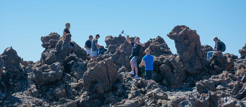 Spain, Tenerife - 09/15/2016: Photoshoot of tourists on the volcanic rocks of the Teide volcano. Stock photography