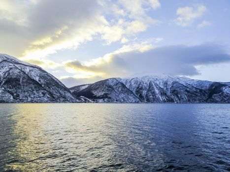 Winter landscape and morning time sunrise at Sognefjord Norway.