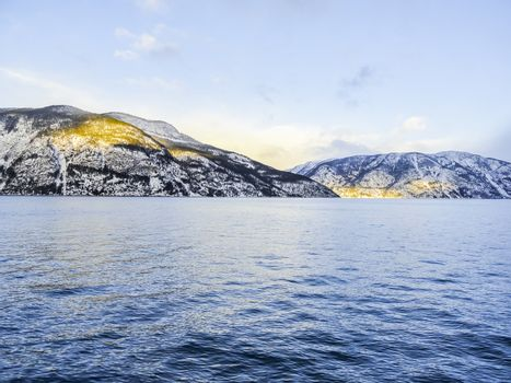 Winter landscape and morning time golden sunrise at Sognefjord Norway.