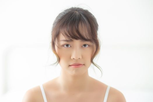 Beautiful portrait young asian woman having worry unhappy and up