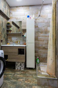 Interior of a cozy compact modern bathroom