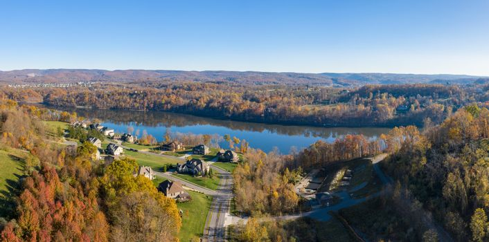 Aerial view of single family homes by Cheat Lake in the fall outside Morgantown in West Virginia