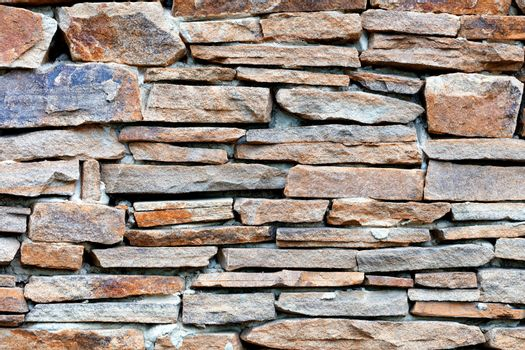 The texture of the wall lined with sandstone stone.