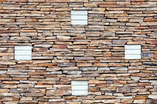 The texture of the wall is lined with sandstone with an ornament of silicate bricks.