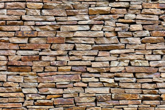 The texture of the wall is lined with sandstone, high resolution.