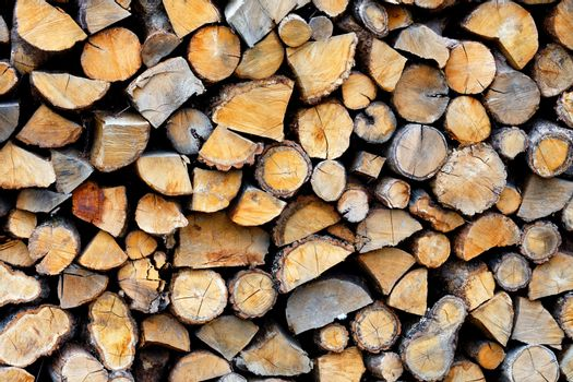 The texture of a stack of chopped firewood.