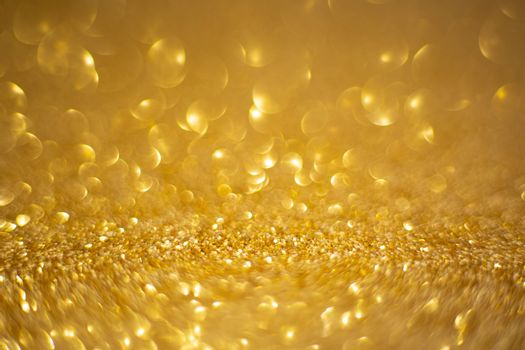 Abstract golden holiday background with bokeh defocused lights with copy space for text