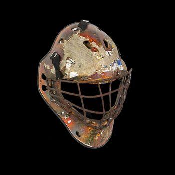 Old hockey mask for goalkeeper protection isolated on black background