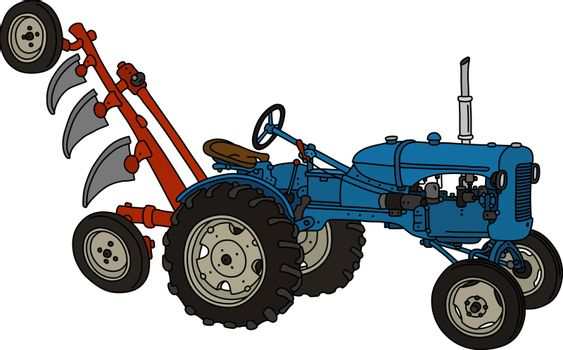 The old blue tractor with a plough